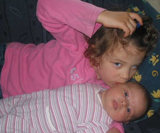Marae loving on her 6 week old baby sister, Elise.