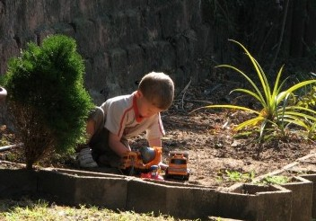 A little boy and his trucks and dirt.  All good!
