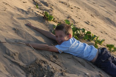 Thankfully the beach photo shoot was already done when he decided to slide down the dunes!