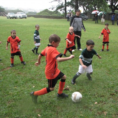 His first soccer match ever - and it was torrentially pouring!  Didn't stop those boys!!