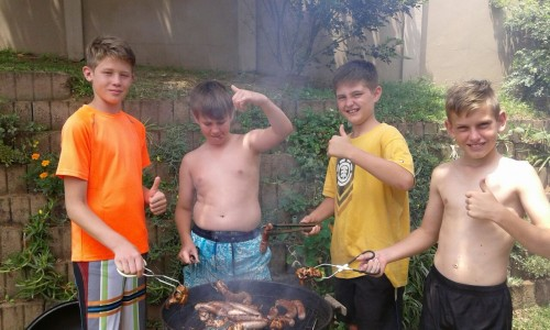 "Learning to braai like ""real South African men!"""