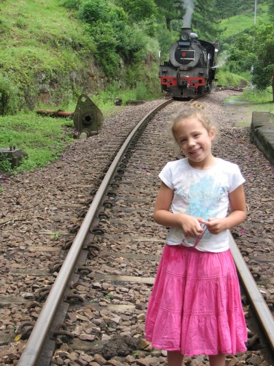 Um, who are the parents of this child standing in the train tracks? ;-)