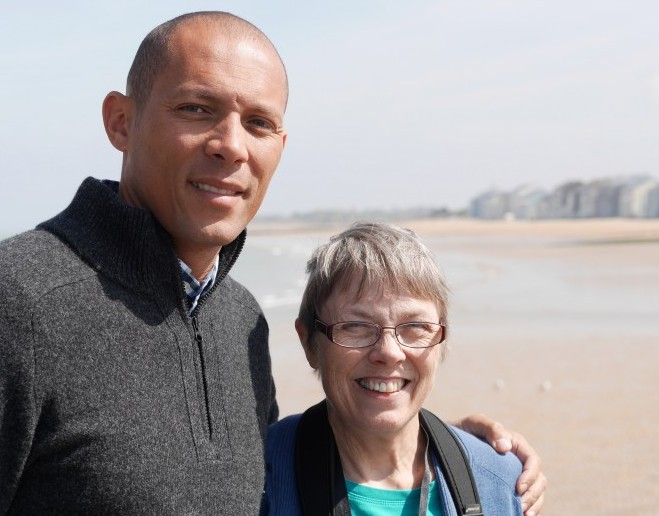 Carl and his mom - posing in front of the beach where his grandfather landed on D-Day.