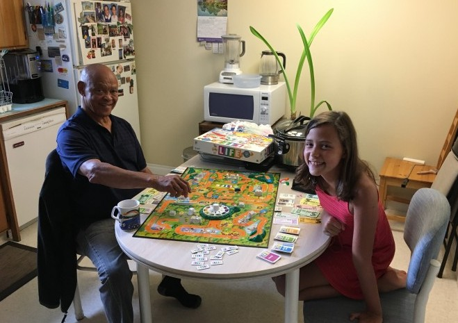 Elise teaching her grandad how to play the game of Life.  ;-)