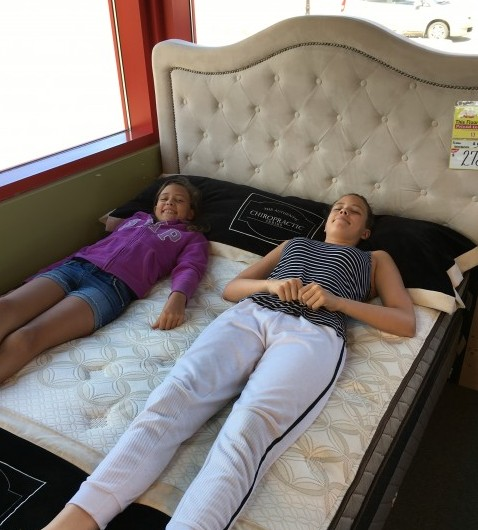 Trying out mattresses!  Do you girls feel that green pea under your mattress?  ;-)